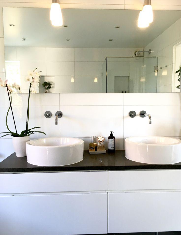 Bathroom with white tile, lava stone, Duravit. Lilla Bruket soap