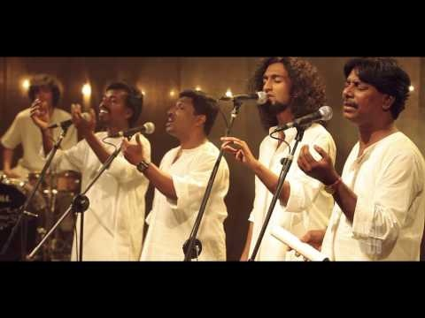 Nammisai by Asima - Music Mojo on Kappa TV. Asima are Anil Ram, Anoop S, Anoop Mohandas, Khalid, Vineeth George (Keyboards), Ben sam Jones (Bass and acoustic guitar), Tao Issaro (Percussion & drums). Composed and arranged by Devissaro. Mixed and mastered by Yakzan Gary Pereira. Directed by Sumesh lal