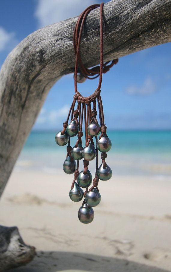 Unique and very natural design for this wonderful grape of 12 superb genuine Tahitian Black pearls from 10 to 12,5mm Half baroque, drop shape B