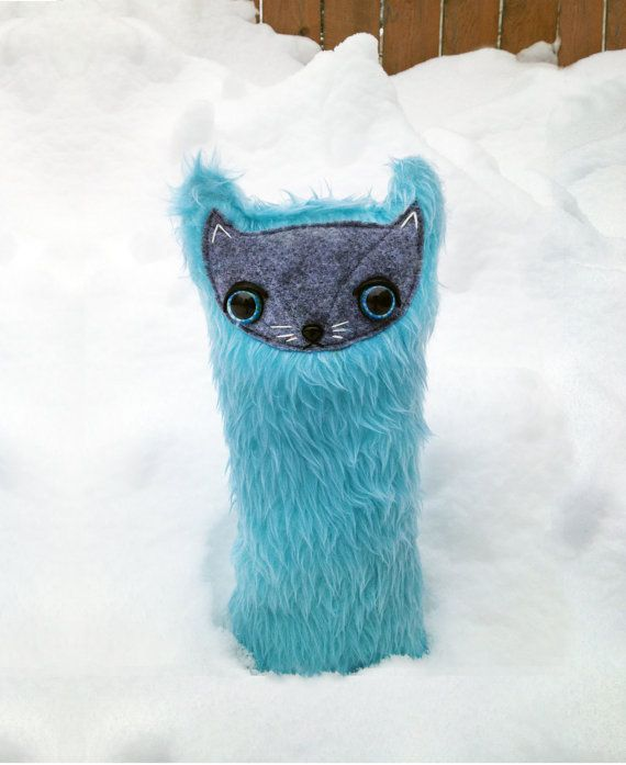 I love this tall, plush cat. Very unique and cool, so it's perfect for an adult cat lover as well!