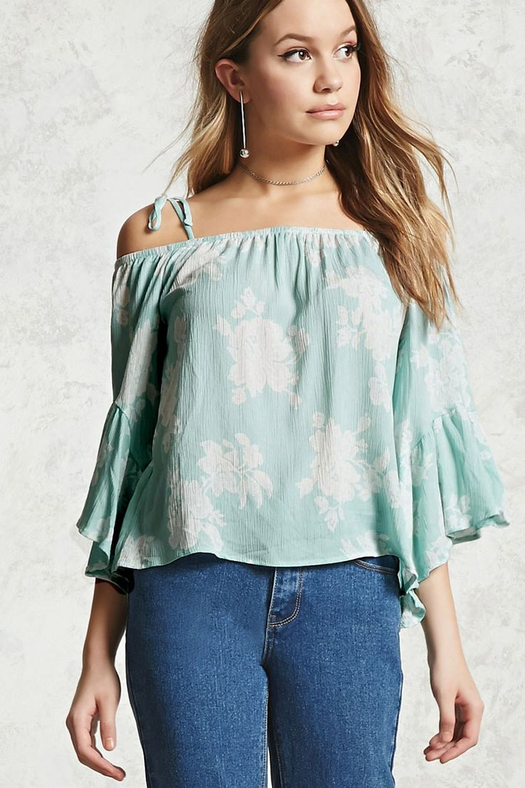 A crinkled woven top featuring an allover floral print, an open-shoulder design, 3/4 bell sleeves, self-tie cami straps, elasticized collar, and a flowy silhouette.