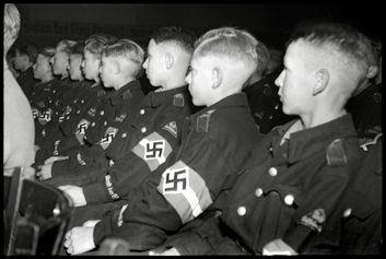 Boys from the Hitler Jugend at a speech. Indoctrination of these boys was an important part in the HJ.