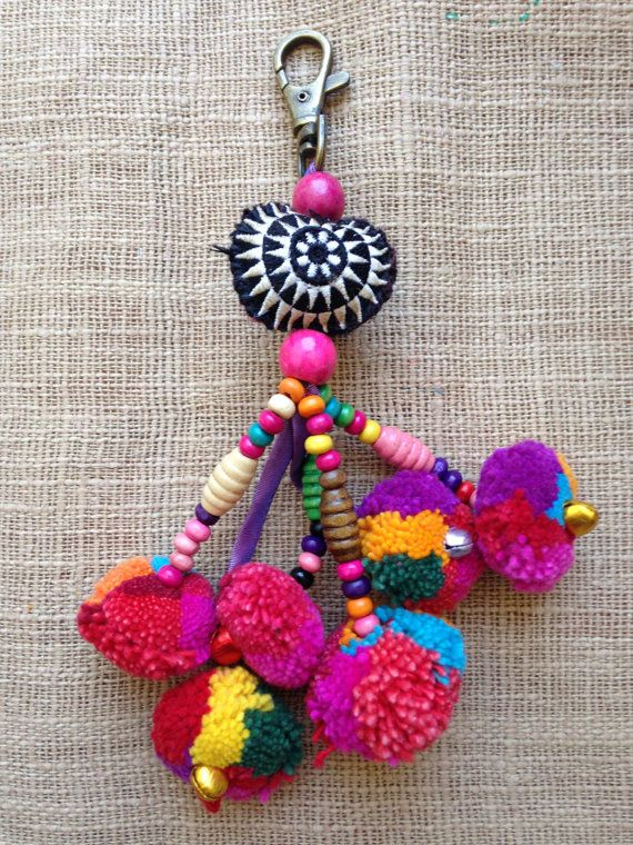 Hmong Handmade Pom pom Beaded cute Charm Keyring Bag Accessory set of 30  This is for 30 charms, each charm is handmade and put together with time and patience. Each quantity you will get the same charm with slight variations in colours as you can see in the pictures. Please note this before putting in your cart. Thank you x x x  Item description: This Hmong fabric charm would be great to brighten up your bag. Charming and cute the fabric is bright and colourful, with beads, poms and a…