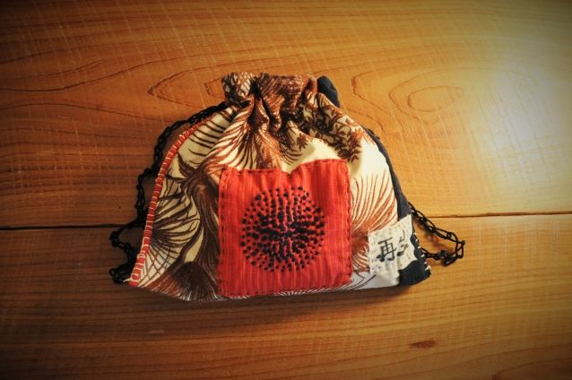 "Japanese Boro Inspired Reticule  Bag/ Sashiko Embroidery/ Upcycled Textiles Japanese Boro Inspired Reticule Artisan Bag. 100% hand stitched using Sashiko stitching technique. Kanji symbol means ""REBIRTH"" or ""REGENERATE"". These bags can be used in so many w..."