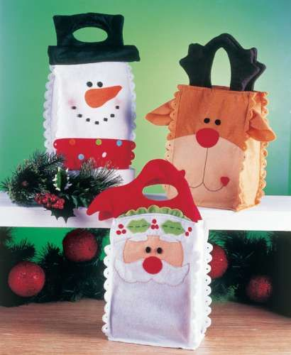 Bolsas de fieltro con personajes navideños Elabora estas bolsas de fieltro con personajes navideños que podrás