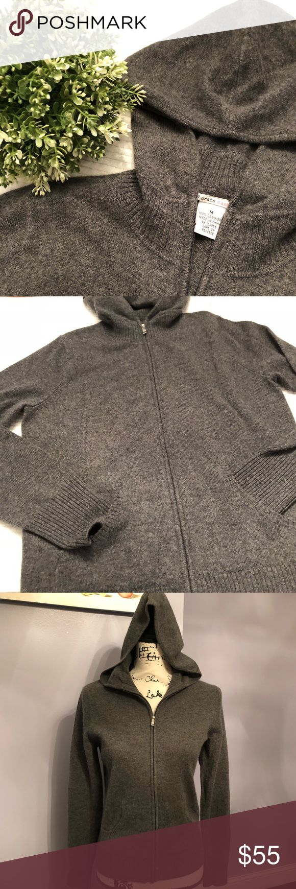 """Cashmere hoodie Evelyn Grace grey 100% cashmere sweater  Full zip up with hood Grey color Long sleeves  Size medium  Like new condition   Measurements are approximate and taken laying flat  Bust 17.5"""" Back length 23"""" Bottom hem 15.5"""" Waist 16.5"""" Bin8 evelyn grace cashmere Sweaters"""