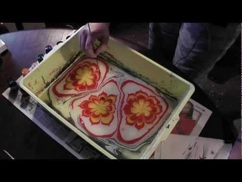 Creating flowers using paper marbling inks.