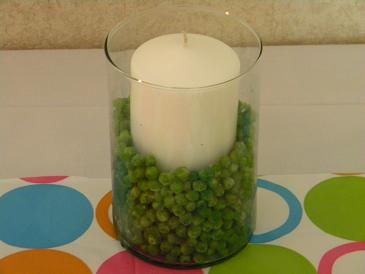 White Unscented Candle Surrounded By Peas