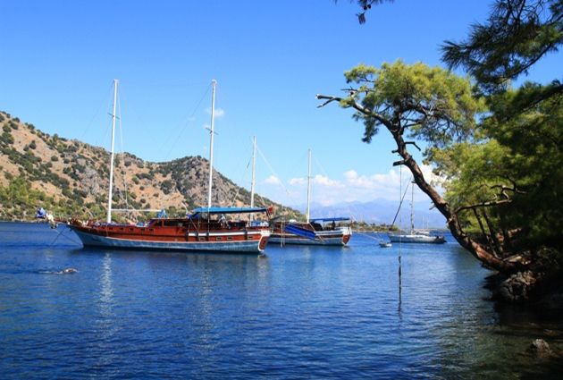 Day 6: GOCEK GULF (MANASTIR - AGA LIMANI) After the breakfast we will cruise to Manastir (Monastery) Bay. Lunch and a swimming break will take place in here. This place is also known as Cleopatra Bay or Sunken Bath Bay due to the beautiful underwater ruins of an old bath. Afterwards we will cruise to Aga Limani for dinner and anchor here for overnight stay.