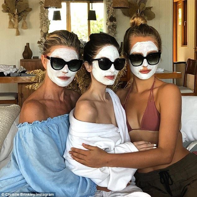 Bonding time: The 63-year-old Sports Illustrated model posed in mud masks withdaughters A...