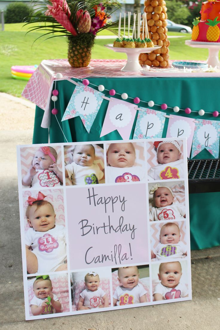 First birthday photo display; photo display; flamingo party ideas; flamingo birthday party ideas