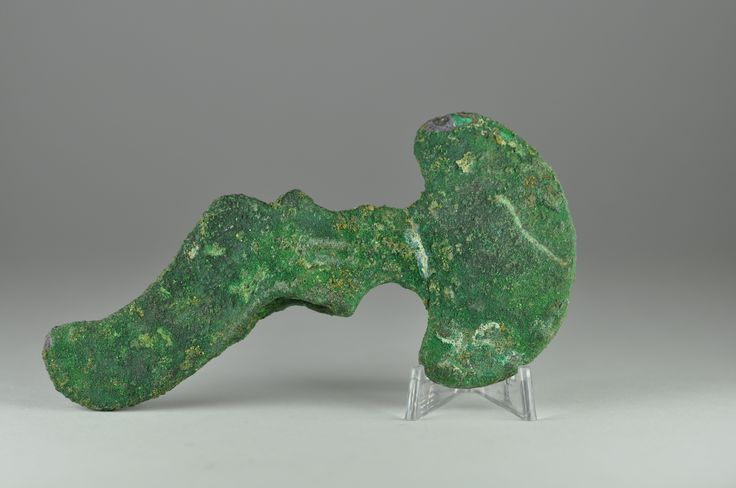 Luristan bronze axe head, 2nd-1st millenium B.C. Luristan bronze axe head, Luristan Bactrian bronze shaft hole axe head with rounded lunate blade, an eye in the middle, 11.2 cm long. Private collection
