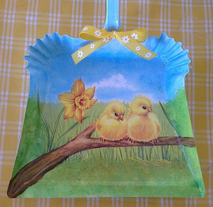 Little chicken on a dustpan