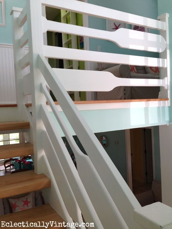 Tour this beautiful beach house filled with creative ideas like this oar stair railing! eclecticallyvintage.com