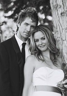 """1990s Clueless star, Alicia Silverstone married Christopher Jarecki on the shores of Lake Tahoe, California on June 11, 2005.  The wedding was entirely green and organic! The wedding featured recycled invitations, organic beeswax candles, bar tops made out of 200-year-old lumber and wine barrel bases, bamboo chairs, and entirely vegan menu. Although a non-denominational ceremony, the officiator exlcaimed, """"Mazel Tov"""" at the end of the service as a nod to Silverstone's Jewish heritage."""