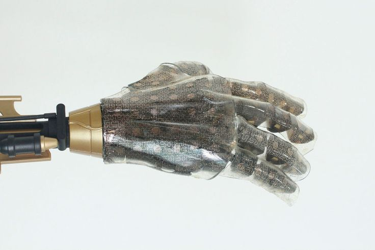 Stretchy artificial skin lets prosthetic hand sense heat, humidity, and pressure.