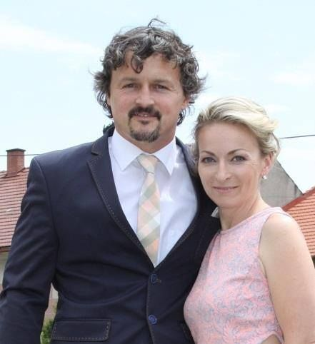 A beautiful couple of wedding guests and our pastel checked necktie...