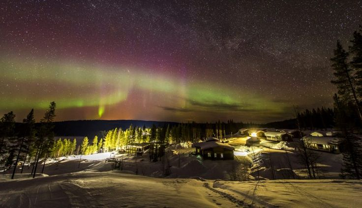 Northern Lights above the Valkea Arctic Experience holiday village at Ritavaara in Pello in Finland