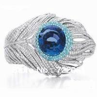 Купить товарМикро вставки перо кольцо 925 серебряной инкрустацией танзанит кольцо женщина в категории Кольцана AliExpress.                 Основной Размер камня: 10 мм                                          &nbs