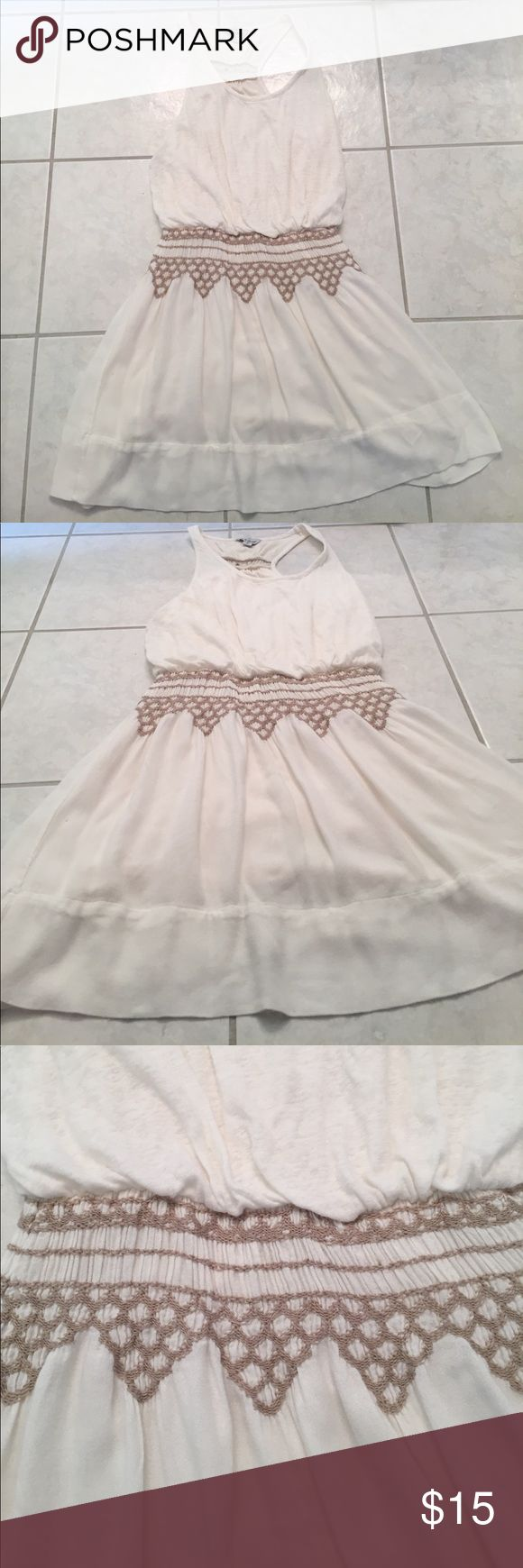 Cream summer dress This dress is great for summer! It is a great cream color with a lining underneath, which makes it not see through at all. It has a great elastic waist with a fun pattern. Lucky Brand Dresses