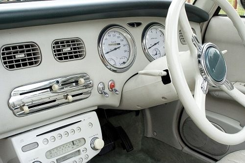 "Nissan Figaro, made in 1991 as a ""retro"" modern car for Japan."