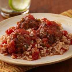 RO*TEL Tex-Mex Meatballs and Rice: An Italian dish with southwestern flare! Baked meatballs, chunky tomato and green chili sauce over rice.