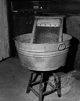 I remember when my Grandma had an old wash tub and washboard like this.  It served for their bath tub also.  And this is what I had for a swimming pool in the summer...my Mum's old wash tub!