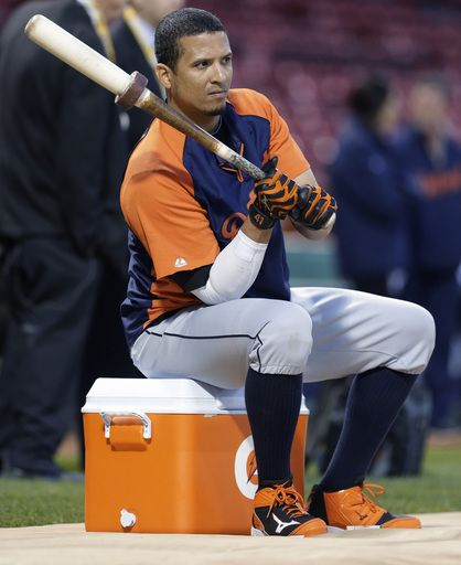 Detroit Tigers designated hitter Victor Martinez sits on a cooler as he waits to take batting practice during the baseball team's workout at...