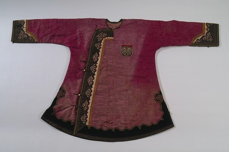 Culture: GOLDE [NANAI] Locale: SIBERIA Country: RUSSIA Material: CLOTH (SILK, COTTON, VELVET), THREAD, RIBBON, BUTTONS (BRASS) Dimensions: L:89 [in CM] Technique: EMBROIDERY, APPLIQUÉ Acquisition Year: 1900   Anthropology