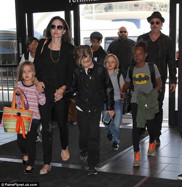 All together: Brad Pitt recently had his first overnight visit with his six kids  - Maddox, 15, Pax, 13, Zahara, 12, Shiloh, 10, and twins, Vivienne and Knox, eight - seen at LAX in June 2015, since Angelina Jolie filed for divorce in September
