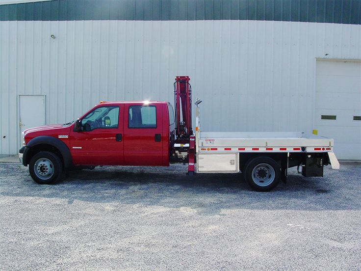 Knuckle Boom Crane Mounted Behind Truck Cab