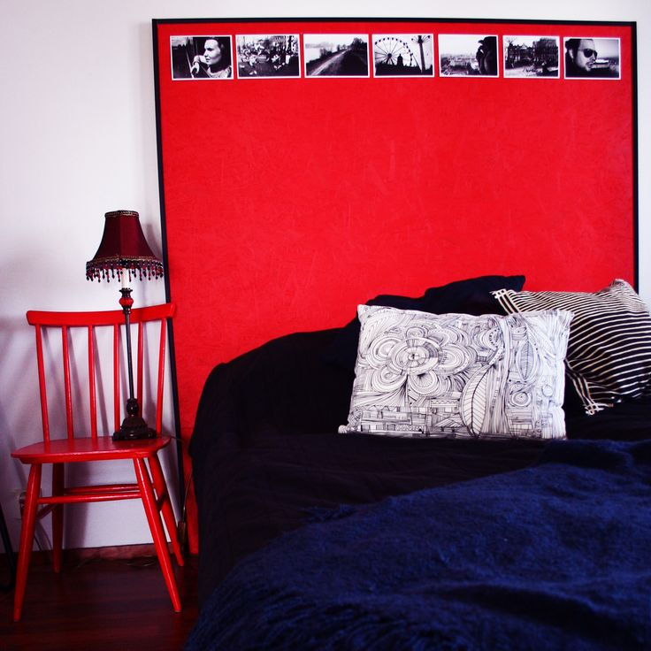 DIY headboard. Painted chipboard and my own black-and.white photos.