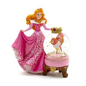 Disney Aurora Snow Globe | Disney StoreFree Delivery - This enchanting Aurora snow globe will cast a spell over any room. It features a delightful rendering of the Sleeping Beauty princess in a pearlescent finish, holding the Owl in the glitter filled dome.