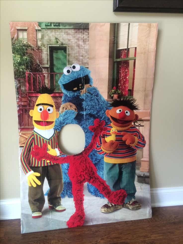Sesame Street Photo backdrop for less than $5. Scene setter from Party City mounted on a project board with Elmo's head cut out. Going to attach posts to the back to put it in the yard and to make the sign more stable.