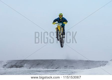 high jump and flight athlete motorcycle on a winter road