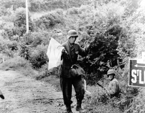 JUL 19 1944 Last stand of the Wehrmacht in St Lo A young German soldier surrenders as the US Army approaches St Lo.