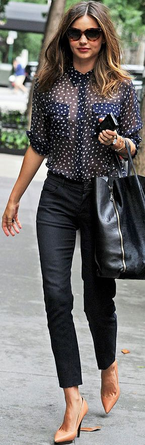 Looks like polka dot but its a star pattern, leather heels, navy blue pants. Miranda Kerr