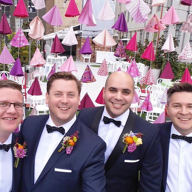These guys!!! Looking so dapper in their @peterjacksonau suits with the most beautiful buttonholes by @undertheivy_ Winning when the ceremony hanging doubles as the perfect photo booth backdrop. #rooftopwedding2015 #wedding #weddinginspo #weddingstyle #ceremonybackdrop #diy #thecolourcurator #photobooth #festive #partydecorations  Wall hanging by The Colour Curator