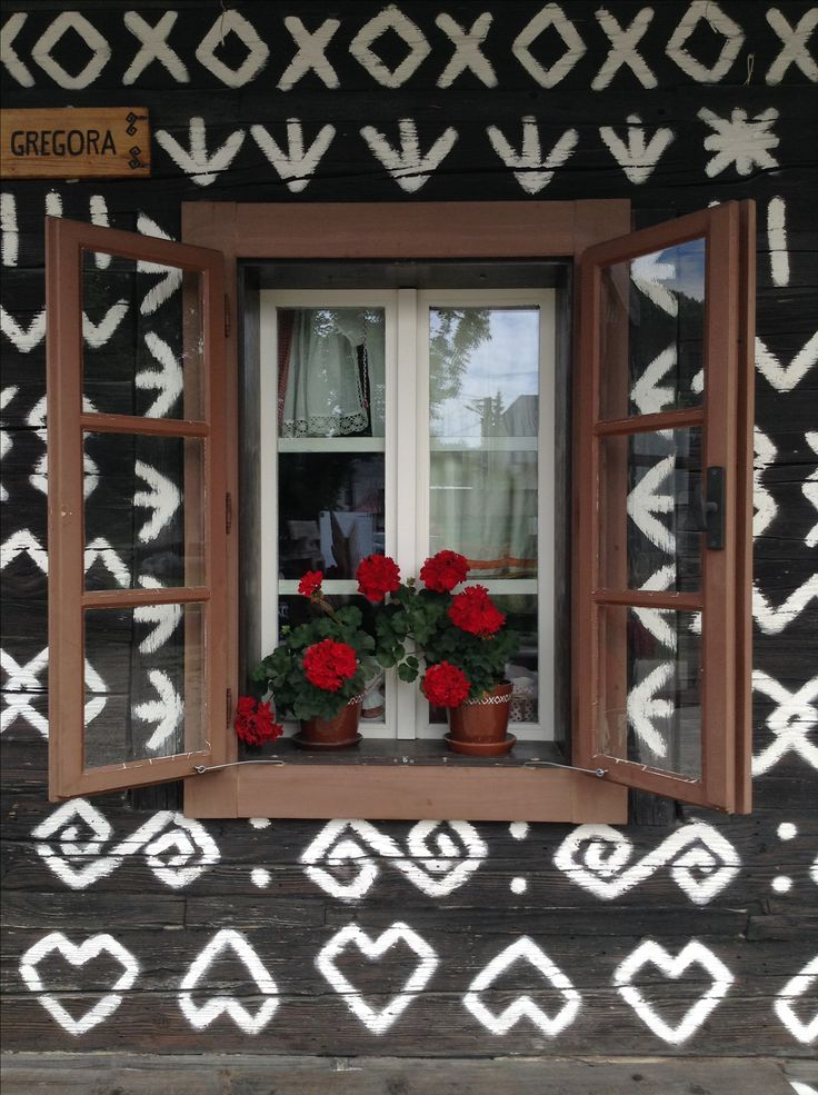 Traditional Slovak folk ornaments on houses in village called Čičmany, (Žilina district, Slovakia)  German name: Zimmermannhau. It is known as the first folk architecture reserve in the world.