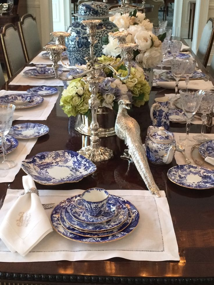 Use white placemats with antique white napkins instead of matching table cloth. Chartreuse in the flowers is nice with the blue and white.