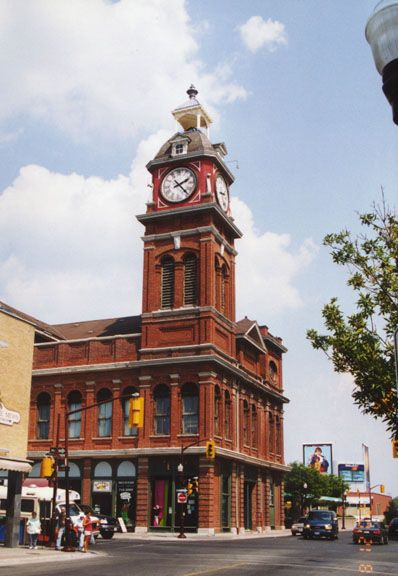 Peterborough, Ontario, Canada. Older picture of the Town Clock, the area around the clock faces is now beige.