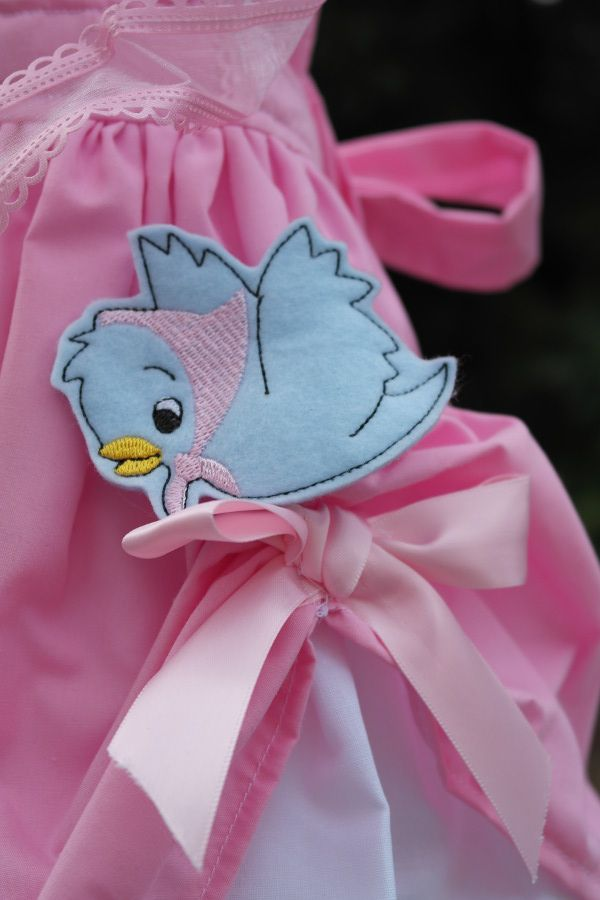 Cinderella birthday party   www.sweetlychicevents.com photos by www.jennifersoucy.com Cinderella's original pink ball gown destroyed by her stepsisters was displayed on a dress form and was adorned with birds and ribbon and matching blue necklace from the film .   #cinderellabirthday