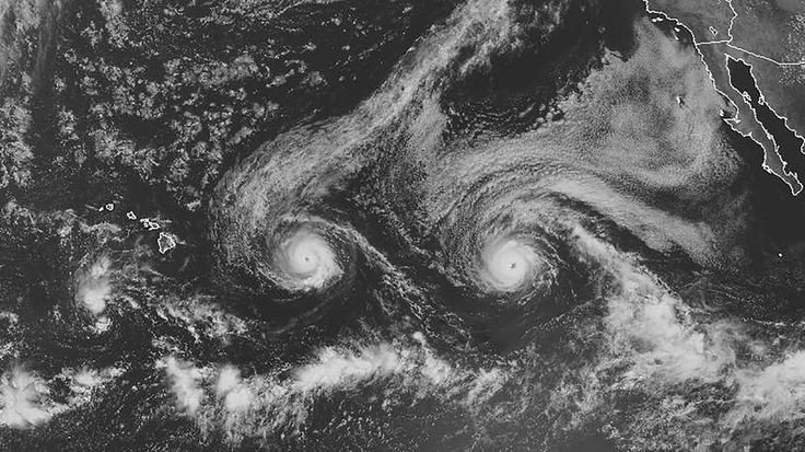 Visible satellite image showing Hurricanes Madeline (left) and Lester (right) moving toward Hawaii on Monday, August 29, 2016.