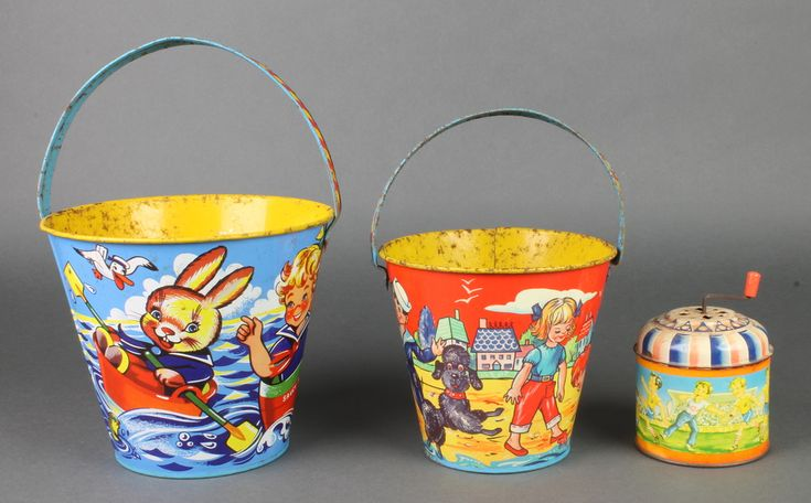"""Lot 239, 2 Chad Valley pressed metal sandcastle buckets 6"""" and 5"""" together with a cylindrical pressed metal musical box decorated a footballing scene 3"""", est £30-50"""