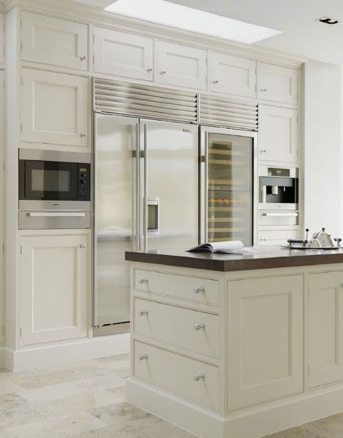 Kitchen Appliance Wall - State of the art appliances - Sub-Zero side by side fridge/freezer w water dispenser & French doors; full size wine fridge; microwave w warming drawer plus a coffee maker all flush with the beautiful floor to ceiling kitchen cabinetry....gourmet all the way!