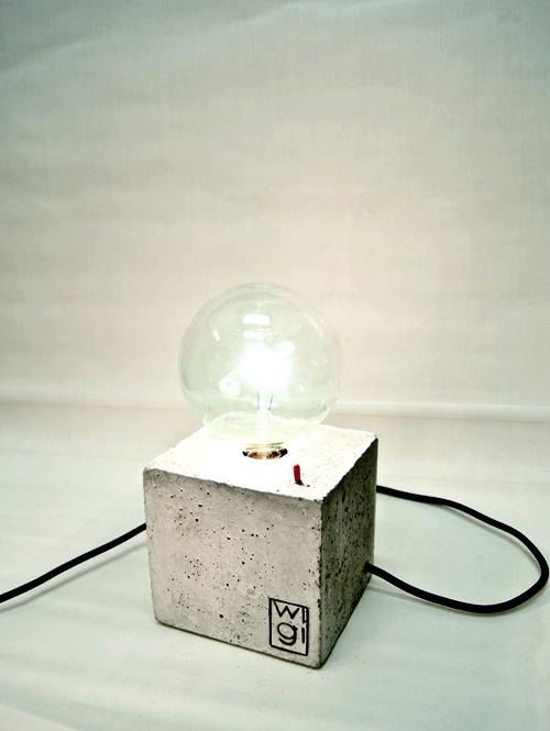 Square is a lamp made of concrete and it has a little red switch to turn on/off the light. You choose the color of the textile cable! Dimensions: