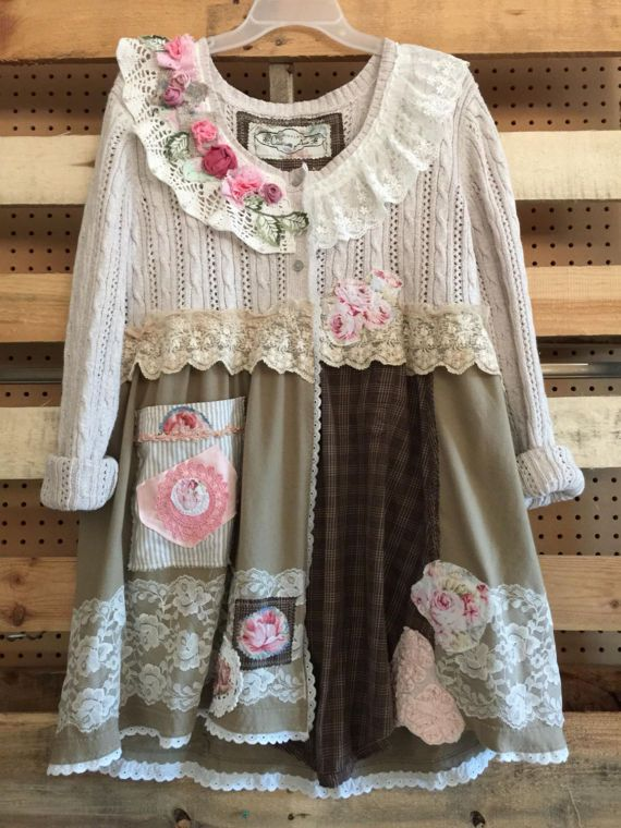 Very Romantic Patchwork Shabby Chic Cardigan Sweater , adorned with Antique vintage Lace doilies and hand made roses. Size Medium to large (Sweater Tag is XL)  (But again I prefer sweaters and Tunics a little bit loose fitting)  Measurements taken laying flat 19 across armpit to armpit 34 long Up to 50 hips