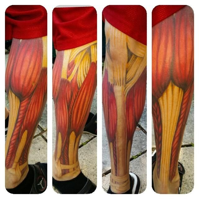 Muscle Tattoo Sleeve: Realistic Muscle Color Leg Sleeve Tattoo.