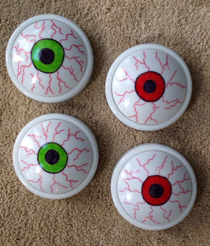 Dollar Tree push lights and sharpie markers make cute/cheap glowing eyes for Halloween decorations.