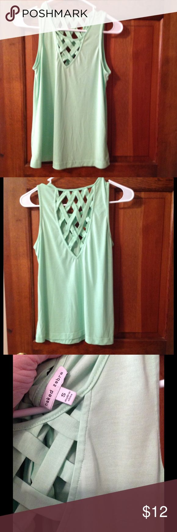 Fun sleeveless top Mint green top. Criss cross designs on the front and back of the shirt. Naked Zebra Tops
